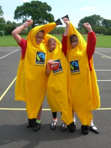 The winning relay team celebrating with their prize of Fairtrade marked Maltesers.