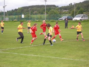 Fancy  footwork in the game between St Giles and St Josephs A